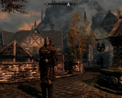 Leona stands before Rifton marketplace in her full leather armor.