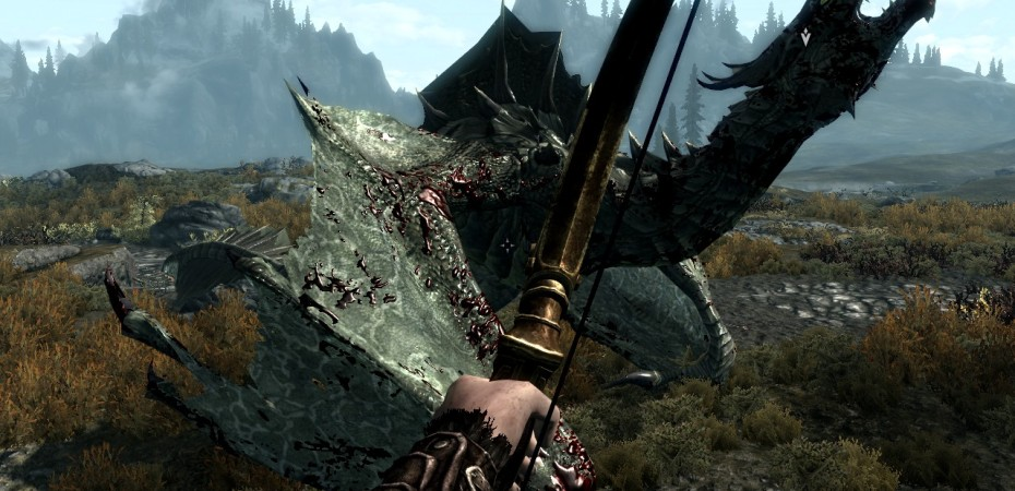 Attacking the downed dragon with arrows.