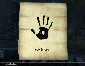 """Simple letter with a black handprint and the words """"We Know"""" below it."""
