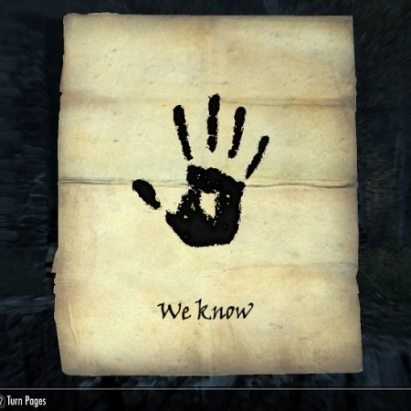 "Simple letter with a black handprint and the words ""We Know"" below it."