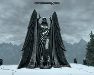 Statue on top of Meridia's temple of a winged woman, arms raised. Behind her lays the distant mountains of Skyrim.