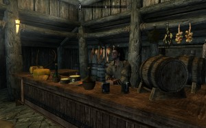 Orgnar stands behind the counter at the Sleeping Giant Inn in Riverwood.