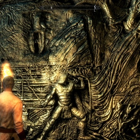 Esbern illuminates the final carved image on the the wall where Alduin returns to fight the dragonborn