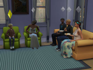 Every seat in the living room is filled with folks for Brennen to talk to.