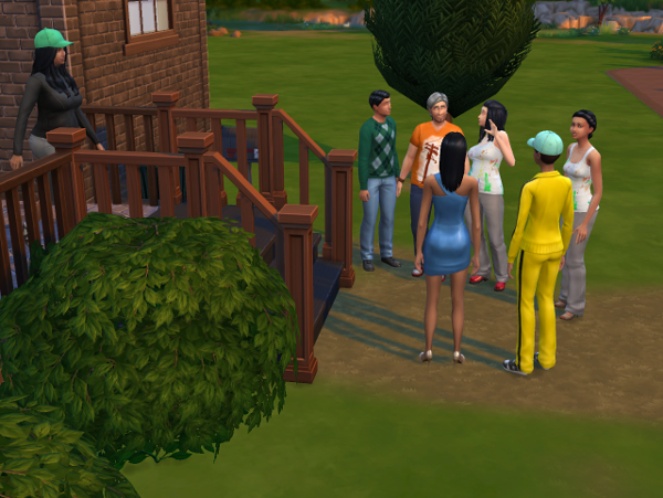 Mitchell and Arthur entertain the girls outside the house.