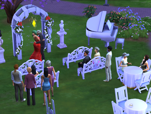 Lemongrass and Mitchell kiss in the wedding arch while the crowd watches.