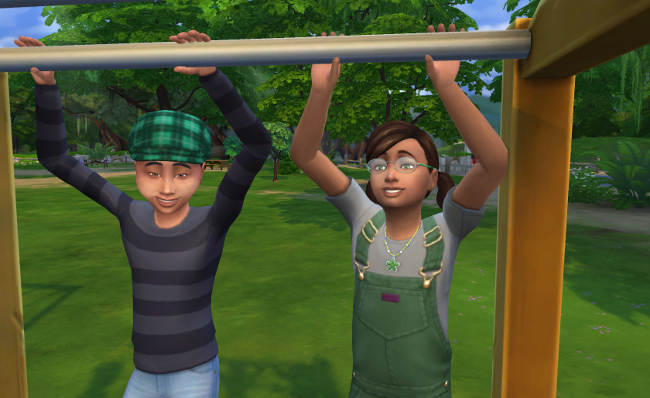 Coral and Rudy stand next to each other on the monkey bars.