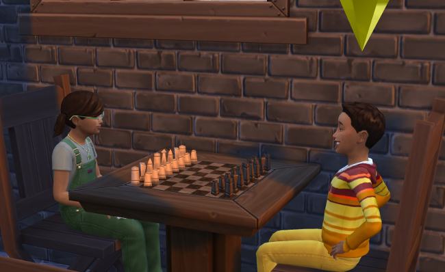 Coral and Reef play chess at the outdoor table.