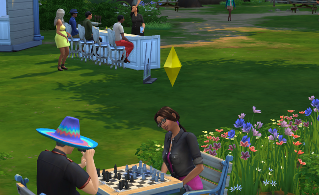 Coral plays chess with her friends.