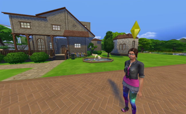 Coral stands in front of the large Pigglewiggle house.