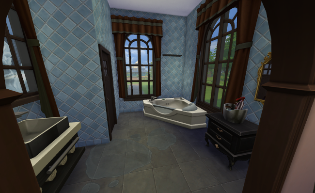 Master bathroom is brown and blue tile, with a huge hot tub and a beautiful view.