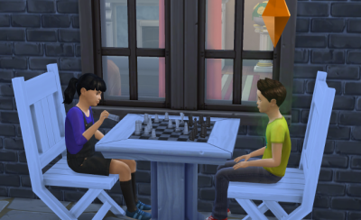 Nikita and AJ playing chess.