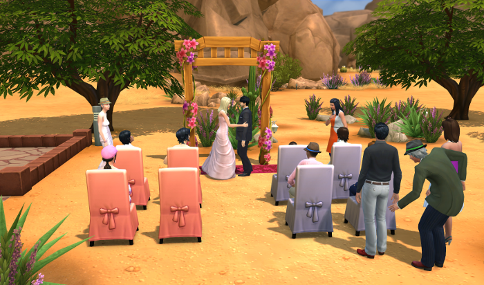 Boris and Bailey exchange vows under the simple arch in the desert part wedding area.