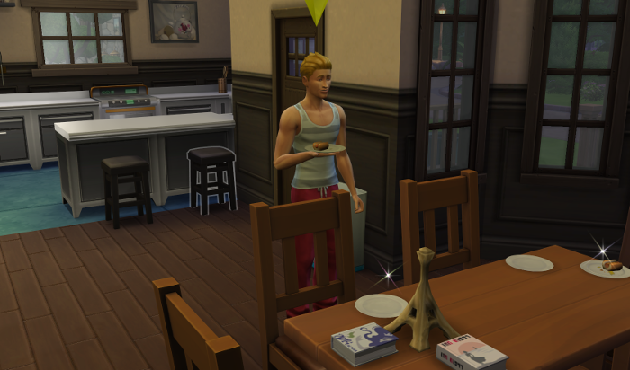 Topher, blond swishy haired and muscular, stands in the kitchen eating breakfast.