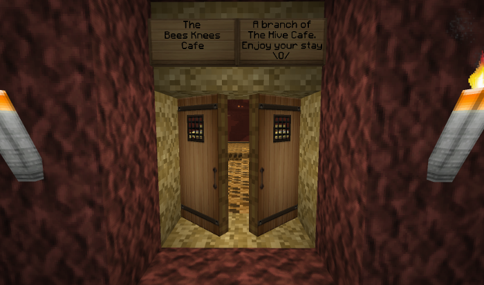 Doors open to reveal the hollowed out hive with cafe.