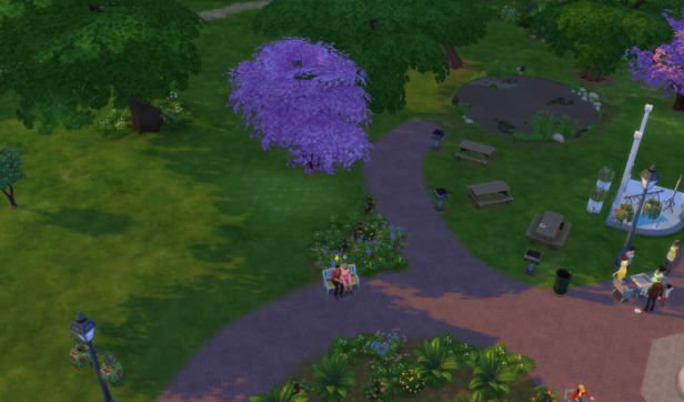 Distant picture of two sims...most likely Mo and a woman in a hat, on a bench in the park.
