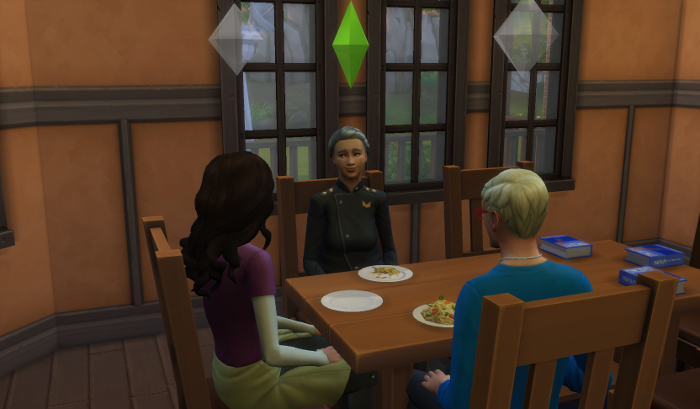 Nebula, Dylan, and Meteor sit around the table for dinner.
