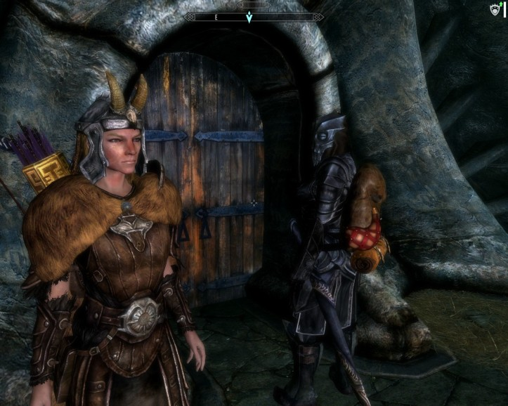 Leona and Borgahk stand together in their house in Raven Rock.