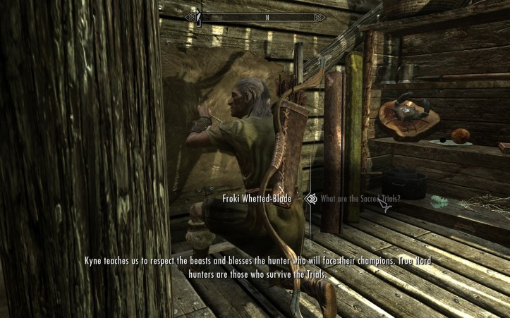 A hunter tans leather in a small house while he talks of Kyne's blessing.