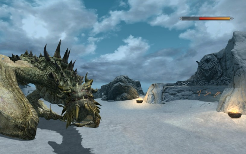 Paarthurnax, a golden dragon sits in front of a word wall that he has just inscribed with the word for fire.