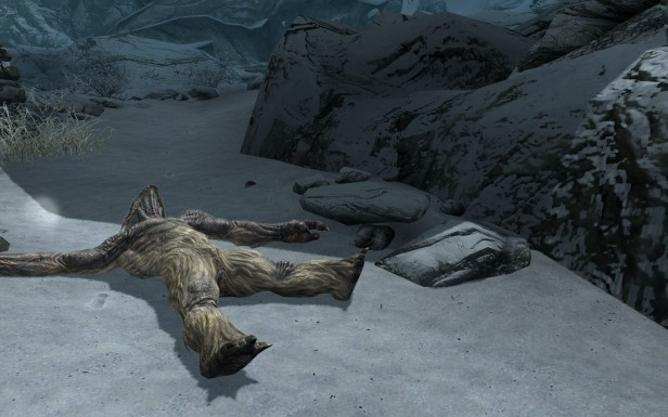A troll lies in the snow.