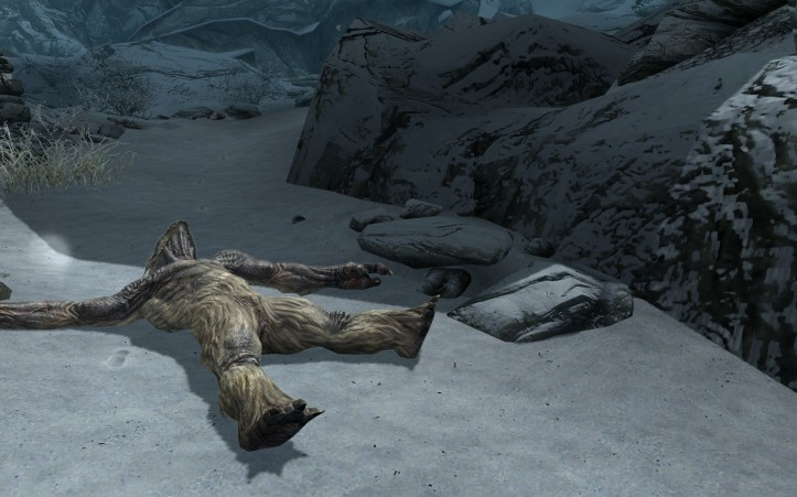 A troll lies in the snow.