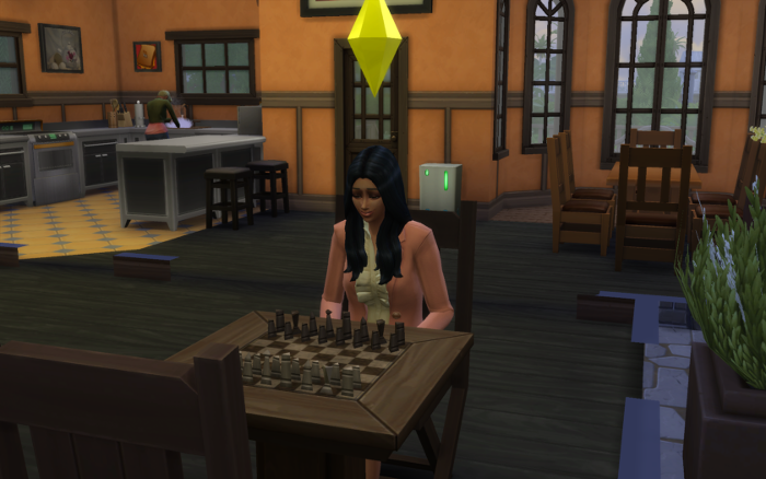 Sonja plays chess in her pink work suit. Behind her, Galaxy is doing dishes.