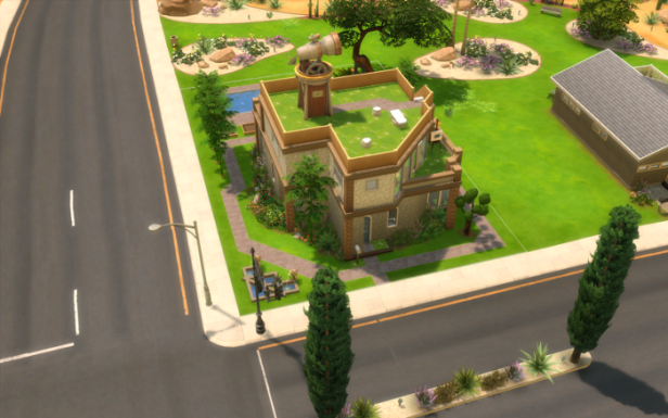Top down view of the house. It's two stories (definitely not square) with lots of windows, sandy coloured stone, and a telescope on the roof.