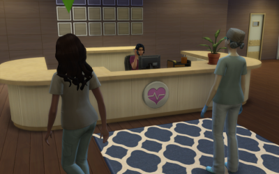 Nebula walks past the front desk of the hospital in her newly acquired scrubs.