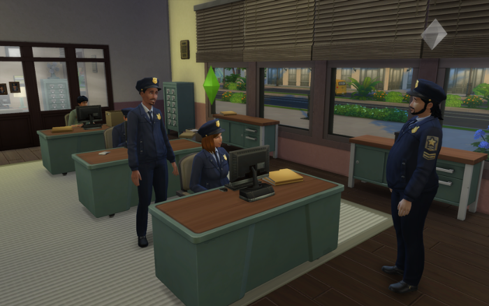 Nova in her detective uniform sits at a table, two of her coworkers are chatting with her.