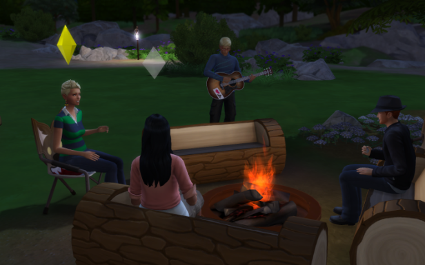 After bedtime, the adults all sit around the fire, chatting. Meteor plays the guitar