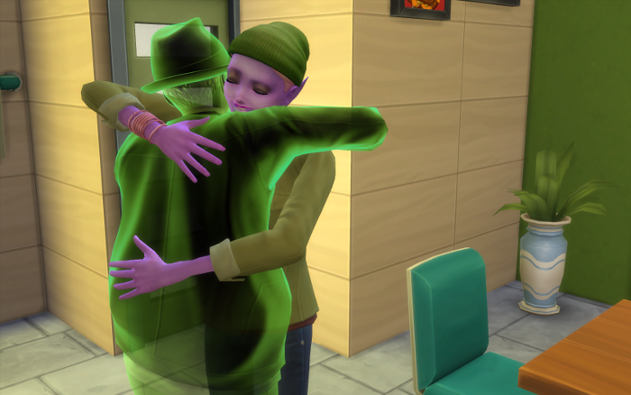 Mina and Darin hug in the kitchen.