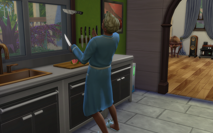 Michel, in his traditional cooking clothes of blue bathrobe and blue bunny slippers, tosses knives while cutting up a watermelon.
