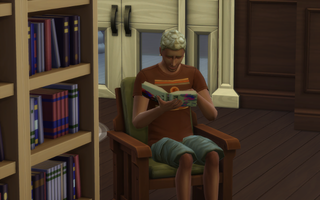 Michel sits in the library pretending to read a book.