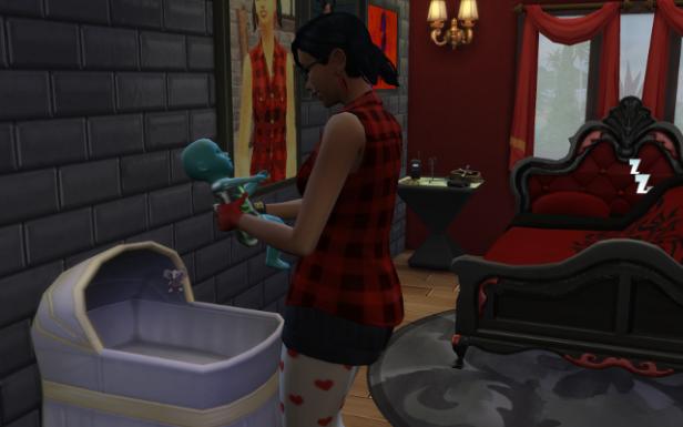 Harley cuddles a little blue baby.
