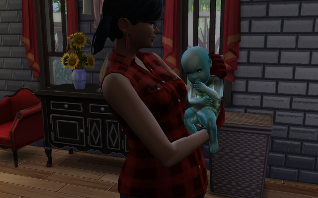 Harley cuddles another blue child. He appears to be glaring.