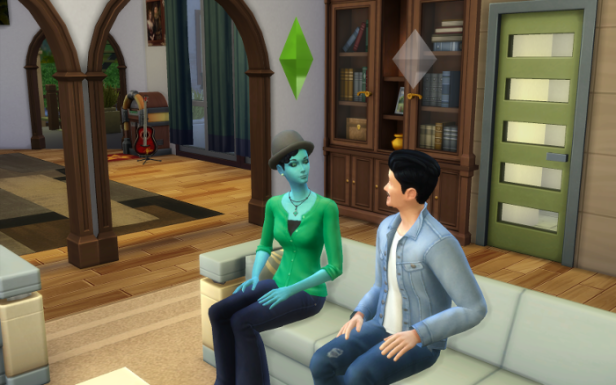 Ivy sits with a sim on the couch.
