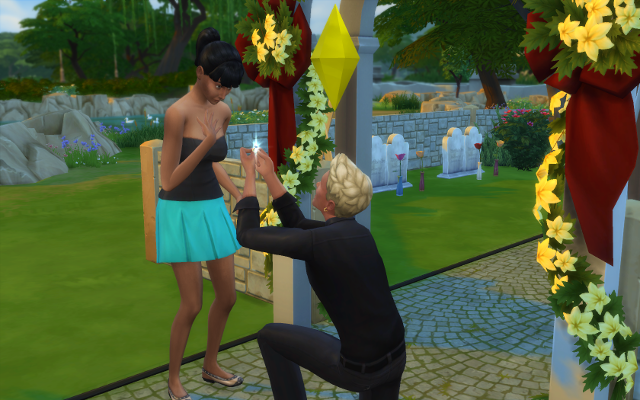 Sadly, unhatted, but dressed formally (formallish) in a blank top and blue mini skirt, Kierra accepts Michel's ring. They were married moments later.