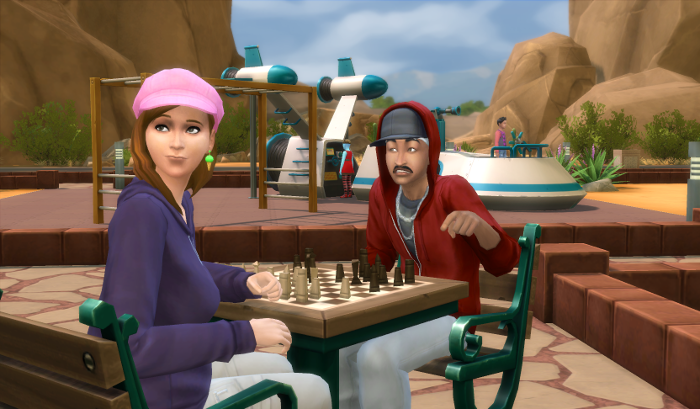 In the background in the space ship playground (you can even see onezero at the helm); in the foreground in Nova in her pink cap playing chess with a man in a red hoodie and a large mustache. He's cheating by making her look away.