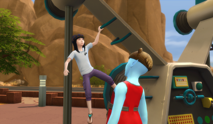 onezero is staring up at a girl in a cap and purple pants who is hanging from the bars attached to the wings of the spaceship playground.
