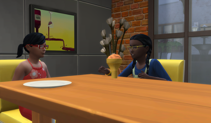 Arianna, left and Elleanor - right, chat at the dinner table.