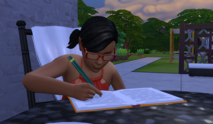 Ari carefully doing her own homework at the same table as the previous picture.