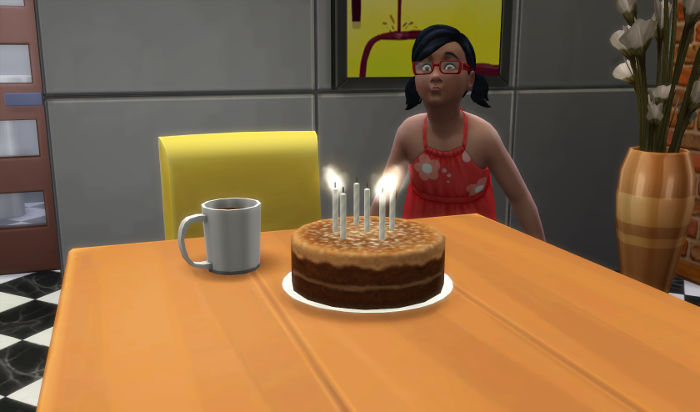 Ari blows out her candles.