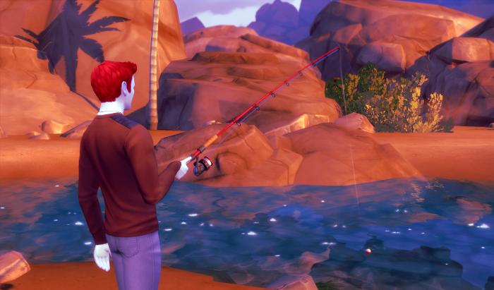 Adam stands in front of a blue blue river, fishing. As always Glassbolt pictures have a bit too much red and blue in them.
