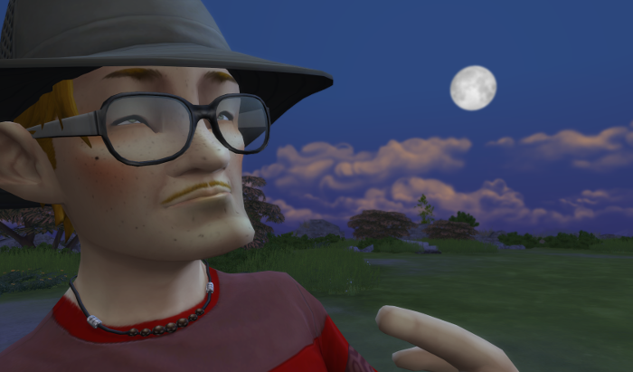 Arturo has a small smile on his thin-mustached face. He wears large glasses and a floppy hat. His chin is overly pointed, his ears are overly large, and his eyes very tiny deep set in the sockets. His face is be-freckled and reddened on the checks from sun or wind.
