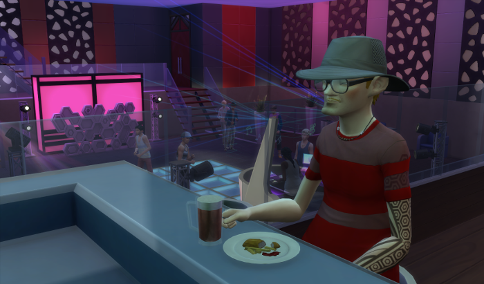 Arturo sits at the bar in the nightclub on Windenburg's waterfront, which looks a bit like a refurbished warehouse. He is eating fish and chips and drinking a beer at the bar. Behind him folks are dancing.