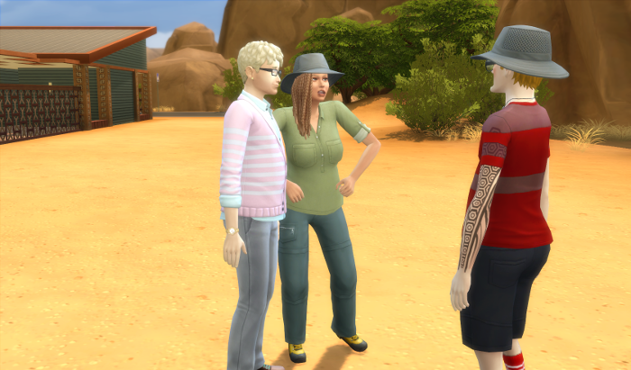 Arturo chats with some visitors to the desert. One woman is wearing the same hat as him. I can't tell if she's upset or not. The guy in the pink and white sweater is probably melting in the desert sun.