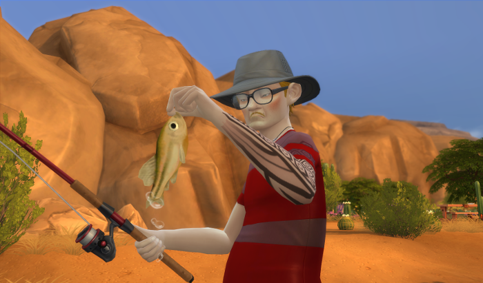 Arturo is NOT happy to see the fish he's holding. His frown is even more pronounced than normal. Poor guy. He's a squeamish sim so fish and frogs and garbage squick him out.