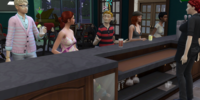 Arturo and Bella have moved down the bar. Katie - who is also red-headed in a pink printed dress sits next to Arturo. Arturo is drinking a beer.