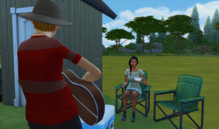 Arturo stands in front of Chana (back to the camera). Chana is sitting in a camping chair eating yogurt.